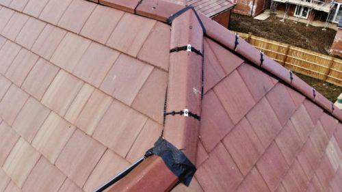 """Linden Homes [Galliford Try]: """"some roof tiles secured with"""